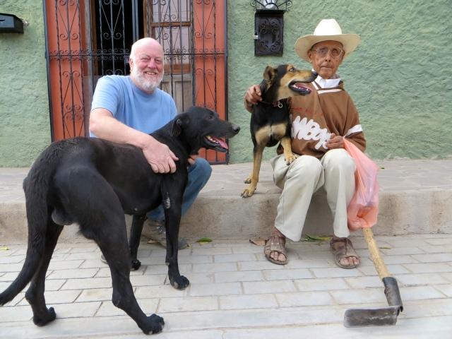 December 25, 2014. Sitting on our stoop, David, Diablo, Perra (Rosario's seeing-eye-dog-in training), and Rosario.