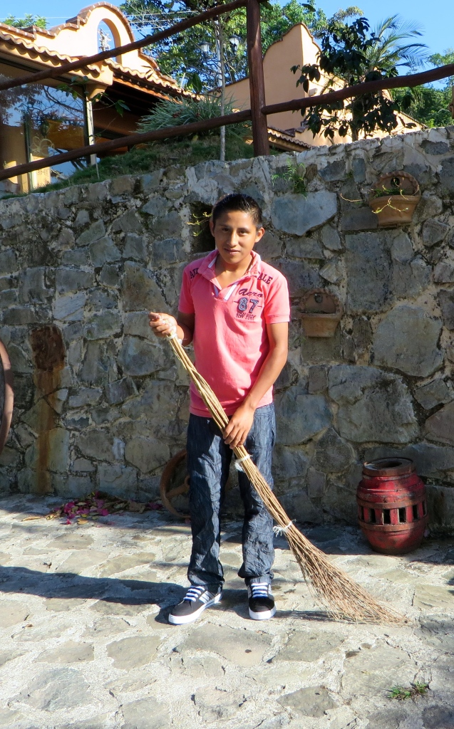 Ezekiel, sweeping with homemade broom at Finca Don Gabriel, Pluma Hidalgo, Oaxaca.