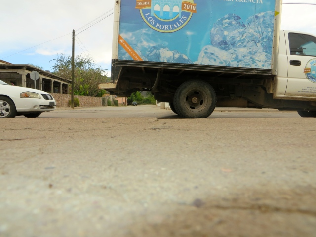 A truck passing over a tope on the verge of the school in our neighborhood, Escuela Primaría Revolución.